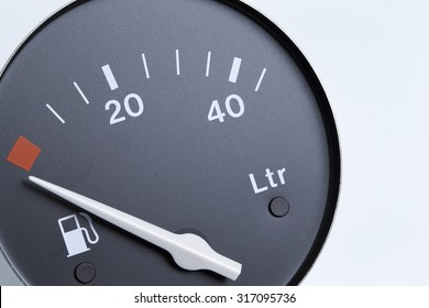 Detailed image from a fuel indicator of an car, isolated on white background
