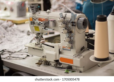 detailed image of professional sewing equipment and sewing thread