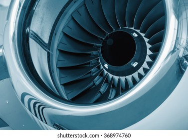 detailed insigh tturbine blades of an aircraft jet engine, colored technical blue
