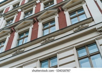 detailed and low angle view of red facaded brick building