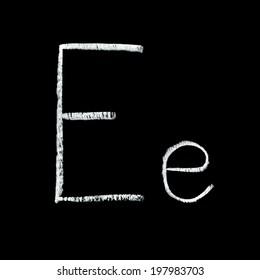 Detailed macro shot of chalkboard letter E isolated on black