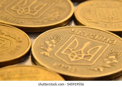 Detailed macro shot of Ukrainian money coins in the form of cash cents. Ukrainian kopeck with detailed metal texture and relief ornament in the form of plants