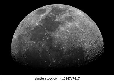 Detailed Moon in waxing gibbous phase with its craters, taken with large diameter telescope isolated in the dark space.