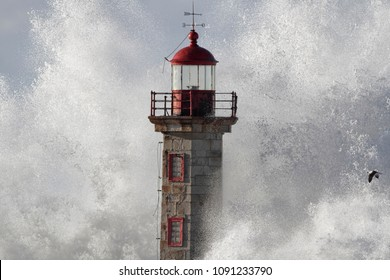 Detailed old lighthouse covered by a big stormy wave splash