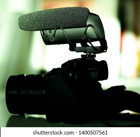 Detailed photograph of new microphone mounted on small mirrorless camera - green color cast