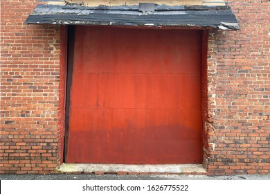 detailed red bay doors alley way old brick wall building barn farm