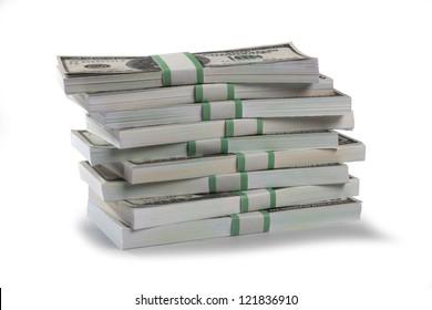 Detailed shot of stacks of US dollars bundle on white background.