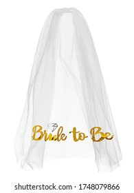 """Detailed shot of a white mesh bride veil with golden lettering """"Bride to Be"""" on the border. The elegant veil is isolated on the white backdrop."""