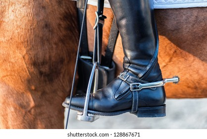 detailed view of a boot rider with spurs wheel