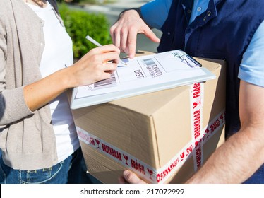 Detailed view of a customer signing delivery note