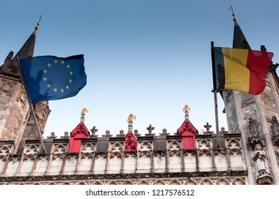 A detailed view of the facade of the Flemish Provincial Court (Provinciaal Hof) with golden angels and European and Belgium flags. Bruges, Belgium, EU