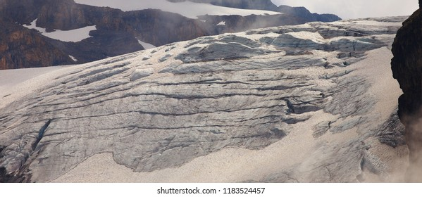 Detailed view of a glacier with long cracks