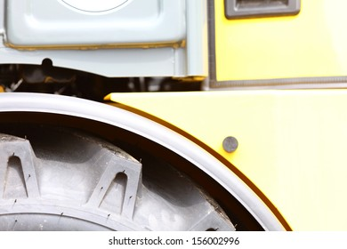 Detailed view of heavy vehicle big wheel of the building dozer or other construction machinery