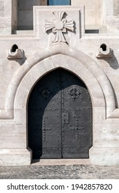 Detailed view of a medieval cathedral door.