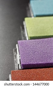 detailed view on beautifully colored stamping pads aligned in a row