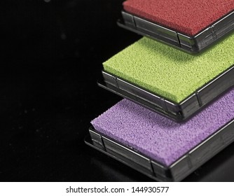 detailed view on colored stamping pads on black background