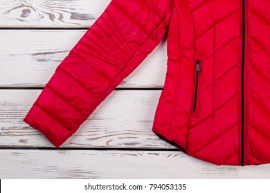 Detailed view on down jacket. Comfort and warmth for winter season. Women's clothing brand new collection.