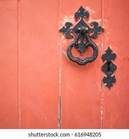 Detailed view on old orange wooden Church door in Skipton, North Yorkshire, England