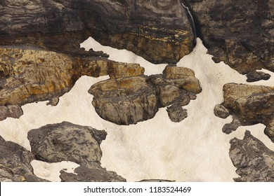 Detailed view of a rocky landscape with rests of a melting snow
