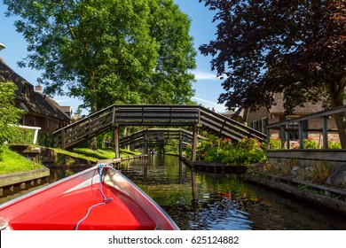 Detailed view of sailboat in canals around farm area. Giethoorn is popular village with thatched houses.