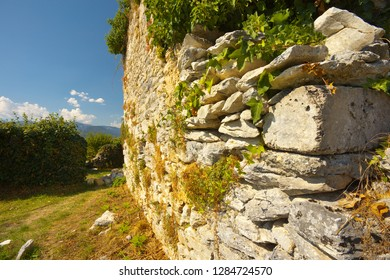 Detailed view of a stony wall, ruins of the former castel of Montousse, France