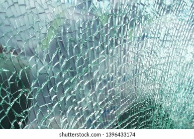 Detailed view of texture of a broken and slivered car window glass