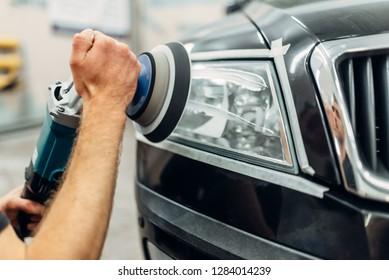 Detailing of car headlights with polishing machine