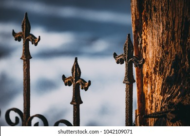 Details of ancient cemetery. Abandoned graveyard. Rusty metal. Black metal album cover photo.