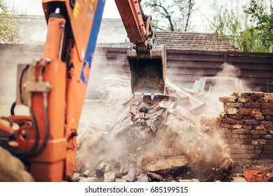 Details of backhoe excavator scoop demolishing ruins, destroying and loading debris