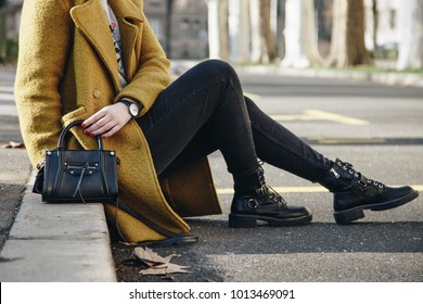 details of a beautiful fashion outfit. stylish young european blogger posing on the street on a sunny day.