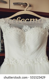 details of beautiful white and gentle wedding dress