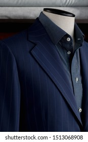 Details of bespoke striped jacket with navy blue shirt. Close-up