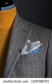 Details of bespoke striped jacket with yellow turtleneck. Close-up