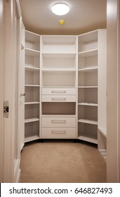 Details of big and new empty wooden closet.