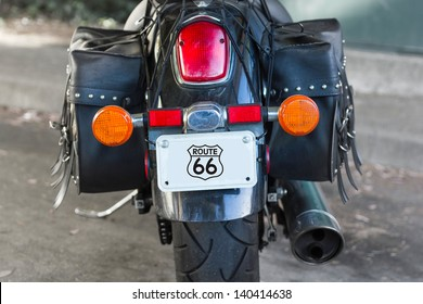 Details of black cruiser motorcycle, rear view.