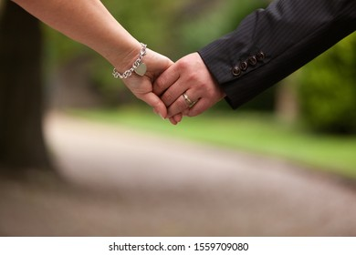 Details of bride and groom hand in hand