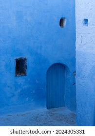 Details of bright blue walls and arches of the narrow streets of the Medina in Chefchaouen, Morocco.