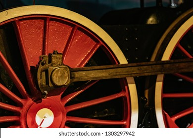 Details of bright red wheels, fragment of old locomotive closeup. Absract vintage background