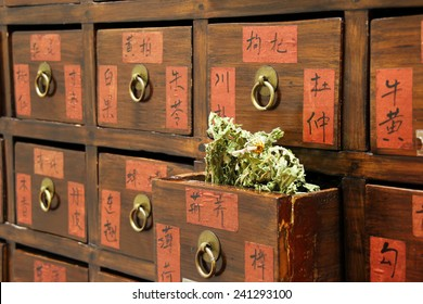 Details of Chinese medicine shop with an open drawer and herbs (manual focus on tripod)