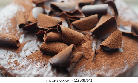 Details of the chocolate in flakes with cacao powder on top. Chocolate Cake with natural light.