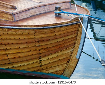 Details of a classical timeless design wooden boat moored in a marina