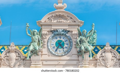 Details with clock on top of the 19th century baroque style palace of the Monte Carlo Casino timelapse in Monaco. Blue sky at summer day
