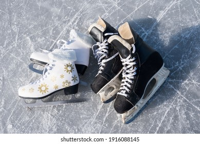Details close up hockey scates on a frozen pond. Ice skating in nature at sunset in winter. Travel and sports