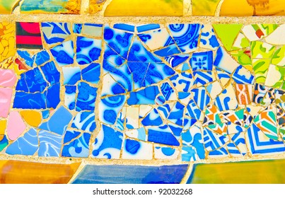 Details of a colorful ceramic bench at Parc Guell designed by Antoni Gaudi, Barcelona, Spain.