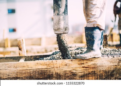 Details of concrete pouring during construction of house. Industrial details, machinery and people