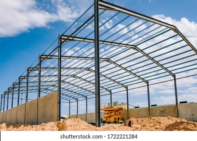 Details of the construction of a steel industrial warehouse with reinforced concrete walls