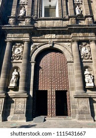 Details of the decorative entrance and beautiful door of a church in Mexico City, Mexico.