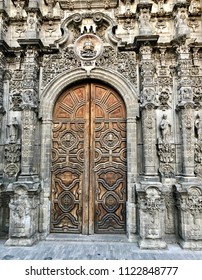 Details of the decorative entrance and wooden door of a church in Mexico City, Mexico.