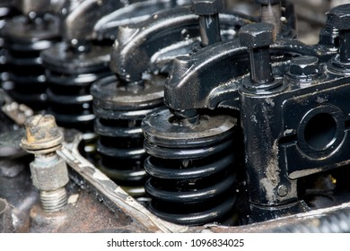 Details of a dirty diesel engine under the hood of an old car