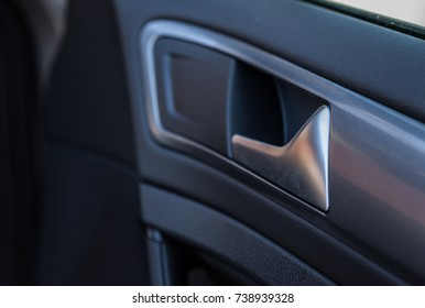 Details of a door handle in a car